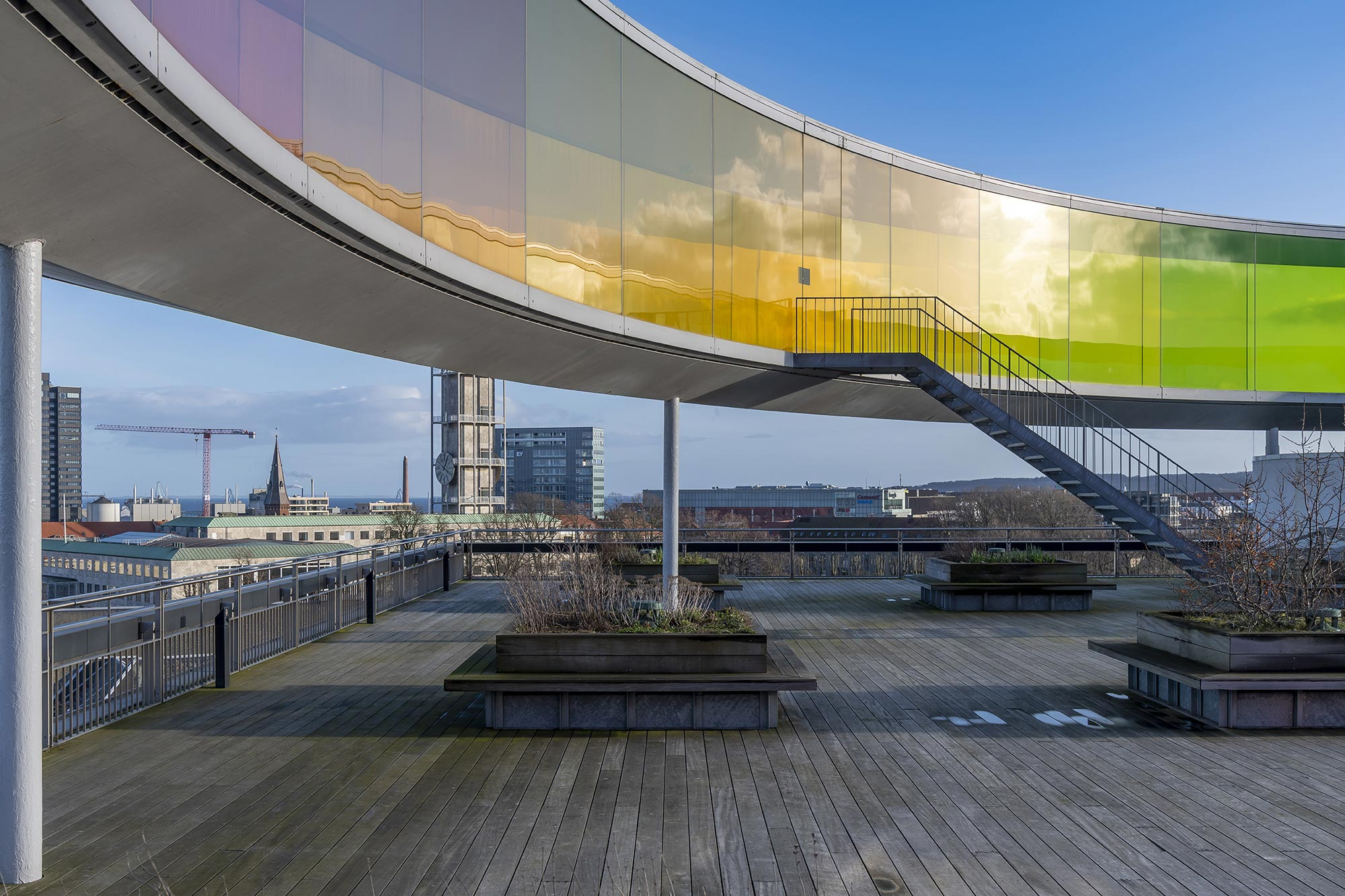 Your Rainbow Panorama by Olafur Eliasson - sits above ARoS gallery in Aahhus , Denmark